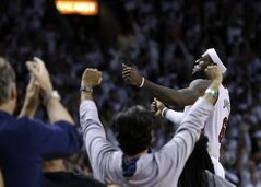 Miami Heat forward LeBron James celebrates their 96-94 win against the Brooklyn Nets during after Game 5 of a second-round NBA playoff basketball game in Miami, Wednesday, May 14, 2014. (AP Photo)