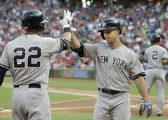 New York Yankees Brett Gardner, right, is congratulated by teammate Jacoby Ellsbury (22) after Gardner solo homered in the first inning of a baseball game against the Texas Rangers Wednesday, July 30, 2014, in Arlington, Texas. (AP Photo/LM Otero)