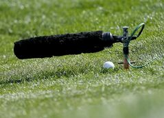 Jordan Spieth ball hits a green-side microphone after a bunker shot on the second hole in his match against Ernie Els, of South Africa, during the fourth round of the Match Play Championship golf tournament on Saturday, Feb. 22, 2014, in Marana, Ariz. (AP Photo/Matt York)