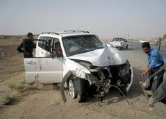 Iraqi policemen prepare to tow away a damaged sport utility vehicle following a drive-by shooting in Kirkuk, 180 miles (290 kilometers) north of Baghdad, Iraq, Monday, July 22, 2013. A provincial council member, Abdullah Sami al-Assai, was killed along with his two bodyguards in a drive-by-shooting near the center of the ethnically disputed northern city of Kirkuk, officials said. (AP Photo/Emad Matti)