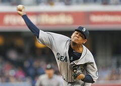 Seattle Mariners starting pitcher Felix Hernandez works against the San Diego Padres during the first inning of a baseball game Wednesday, June 18, 2014, in San Diego. (AP Photo/Lenny Ignelzi)
