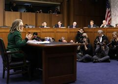 Secretary of State Hillary Rodham Clinton faces the Republican members of the Senate Foreign Relations Committee as she answers questions about the deadly September attack on the U.S. diplomatic mission in Benghazi, Libya, that killed Ambassador Chris Stevens and three other Americans, on Capitol Hill, Wednesday, Jan. 23, 2013. On the dais, from left are, Sen. Rand Paul, R-Ky., Sen. John Barrasso, R-Wyo., Sen. John McCain, R-Ariz., Sen. Jeff Flake, R-Ariz., and Sen. Ron Johnson, R-Wisc.