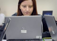 Alysha Griffin works on a laptop computer at ElancOnline inside Garden Spot High School in New Holland, Pa., Nov. 7, 2012. People will still spend more time on personal computers in 2013 than they will on tablets and smartphones, despite the popularity of these smaller devices, says a new tech trends report. THE CANADIAN PRESS/AP Photo/Intelligencer Journal/Lancaster New Era, Blaine Shahan