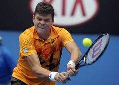 Milos Raonic of Canada plays a shot to Grigor Dimitrov of Bulgaria during their third round match at the Australian Open tennis championship in Melbourne, Australia on Jan. 18, 2014. Milos Raonic has withdrawn from Canada's Davis Cup team with an ankle injury. THE CANADIAN PRESS/AP - Andrew Brownbill