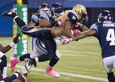 Winnipeg Blue Bombers running back Chad Simpson, centre, may get another chance to shine in the Bombers' running game when they face Hamilton on Saturday