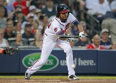 Atlanta Braves Ervin Santana (30) bunts in the fifth inning to advance Gerald Laird to second base in a baseball game against the Philadelphia Phillies Tuesday, June 17, 2014, in Atlanta. (AP Photo/Todd Kirkland)