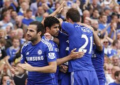 Chelsea's Diego Costa, second left, celebrates his goal against Leicester City with teammates during their English Premier League soccer match at Stamford Bridge, London, Saturday, Aug. 23, 2014. (AP Photo/Sang Tan)