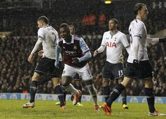 West Ham United's Modibo Maiga, center, celebrates his goal against Tottenham Hotspur during their English League Cup quarterfinal soccer match at White Hart Lane, London, Wednesday, Dec. 18, 2013. (AP Photo/Sang Tan)
