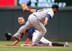 Minnesota Twins' Jordan Schafer loses his helmet as he is tagged out by Cleveland Indians shortstop Mike Aviles, right, during a steal-attempt in the seventh inning of a baseball game, Thursday, Aug. 21, 2014, in Minneapolis. The Twins won 4-1. (AP Photo/Jim Mone)