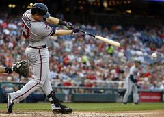 Atlanta Braves' Chris Johnson hits a two-RBI single during the fourth inning of a baseball game against the Washington Nationals at Nationals Park Thursday, June 19, 2014, in Washington. (AP Photo/Alex Brandon)