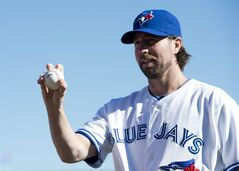 Toronto Blue Jays starting pitcher R.A. Dickey shows off his knuckleball grip at Blue Jays picture day during baseball spring training in Dunedin, Fla., on Monday, Feb. 18, 2013. THE CANADIAN PRESS/Nathan Denette