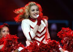 FILE - In this Nov. 8, 2012, file photo, Madonna performs at the Joe Louis Arena in Detroit. A later-than-usual start for a Madonna concert in Miami angered fans in attendance. The Miami Herald reports that Madonna didn't take the stage until just after 11:30 p.m. Monday, Nov. 19, 2012. (Photo by Gary Malerba/Invision/AP)