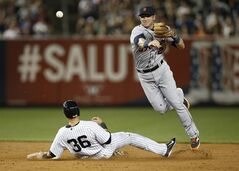 Detroit Tigers shortstop Andrew Romine (27) throws to first after forcing out New York Yankees designated hitter Carlos Beltran (36) when the Yankees Brian McCann (34) hit into a fifth-inning, inning-ending, double play in a baseball game at Yankee Stadium in New York, Monday, Aug. 4, 2014. (AP Photo/Kathy Willens)