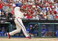 Philadelphia Phillies' Jimmy Rollins hits a single during the fifth inning of a baseball game against the Chicago Cubs, Saturday, June 14, 2014, in Philadelphia. This single gives Jimmy Rollins the all time hits leader for the Philadelphia Phillies. (AP Photo/Chris Szagola)