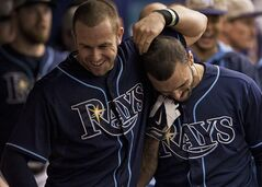 Tampa Bay Rays' Evan Longoria, left, and Sean Rodriguez, right, celebrate in the dugout after Rodriguez' three-run homer during the seventh inning of a baseball game Sunday, May 25, 2014 in St. Petersburg, Fla. (AP Photo/Steve Nesius)
