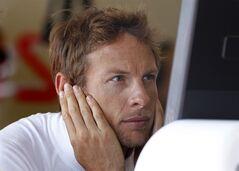 McLaren Mercedes driver Jenson Button of Britain looks a monitor in the pits, during the first practice session at the Monaco racetrack, in Monaco, Thursday, May 24, 2012. The Formula one race will be held on Sunday. (AP Photo/Luca Bruno)