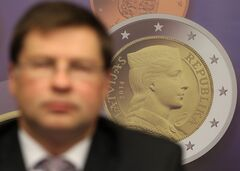 A reproduction of a Latvian euro coin is displayed, as Latvian Prime Minister Valdis Dombrovskis addresses the media on the adoption of the euro, at the European Council building in Brussels, Tuesday, July 9, 2013. European finance ministers are welcoming Latvia's upcoming adoption of the euro currency as a bright spot of progress amid the wider economic gloom. (AP Photo/Yves Logghe)