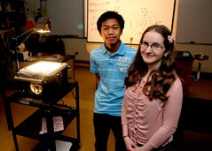 Chris Lansang and Annie Ross, two SJASD Grade 9 students, won a bronze medal at the Canada-Wide Science Fair for their project on multi-tasking.