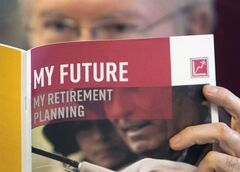 A man looks over a brochures of retirement savings options, on February 3, 2012 in Montreal. THE CANADIAN PRESS/Ryan Remiorz