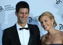 FILE - In this Monday, July 8, 2013 file photo, Novak Djokovic, and Jelena Ristic arrive at a Gala dinner at the Roundhouse in Camden, north London, for the inaugural London fundraiser in aid of the Novak Djokovic Foundation. Novak Djokovic has tied the knot. The Wimbledon champion married his longtime girlfriend Jelena Ristic on Thursday, July 10 in an upscale resort on the Adriatic coast in Montenegro. Local media say the couple held a private ceremony, attended by family, friends and guests, but away from public eye. Authorities in Montenegro have sealed off Milocer and Sveti Stefan resorts to grant privacy. Djokovic and Ristic first met in high school. They have been a couple for more than eight years and are expecting their first child. (AP Photo/Ben Curtis, file)