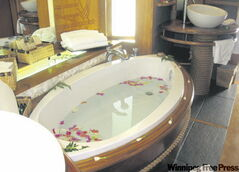 Flower petals in the bathtub at Le Taha'a Private Island Resort and Spa.