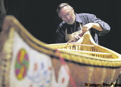 A museum volunteer restores a 14-foot birchbark canoe.
