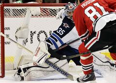 Winnipeg Jets goalie Al Montoya (35) blocks a shot by Chicago Blackhawks forward Marian Hossa (81) during the second period of Wednesday's game in Chicago.