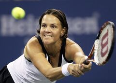 FILE - In this Aug. 27, 2008 file photo, Lindsay Davenport makes a return against Alisa Kleybanova at the U.S. Open tennis tournament in New York. Chris Evert and Lindsay Davenport are taking a swing at acting as guest stars on