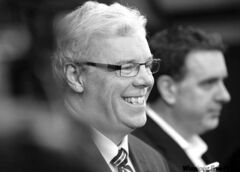 Premier Greg Selinger   beams at Tuesday's news  conference.
