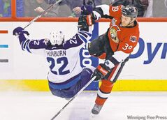 Ottawa's Matt Carkner sends Winnipeg Jet Chris Thorburn flying during second-period action Monday night in Ottawa.