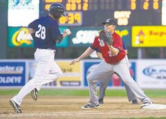 Winnipeg Goldeyes' Kyle Day is out at first as Wichita Wingnuts' Greg Porter makes the catch at Shaw Park on Friday night.