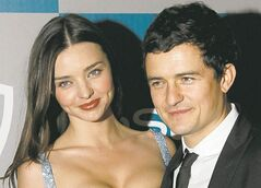 Miranda Kerr, left, and Orlando Bloom arrive at the 2012 Warner Bros. and InStyle Golden Globe After Party at the Beverly Hilton in Los Angeles. on Sunday, Jan. 15, 2012. (AP Photo/Matt Sayles)