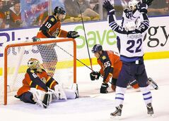 Jets' Chris Thorburn and Blake Wheeler celebrate a goal in a winning effort in Florida last April. While the Jets and Panthers split the series, the rivalry is neither easy nor natural.