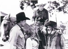 Bob Nolan, Dale Evans, Roy Rogers (on horseback), Gabby Hayes in Along The Navajo Trail, 1945.