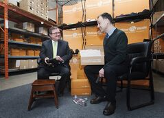 Finance Minister Jim Flaherty tries on a pair of shoes in Toronto on Friday February 7, 2014. THE CANADIAN PRESS/Aaron Vincent Elkaim