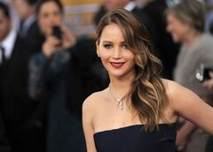 Jennifer Lawrence arrives at the 19th Annual Screen Actors Guild Awards at the Shrine Auditorium in Los Angeles on Sunday Jan. 27, 2013. (Photo by Chris Pizzello/Invision/AP)