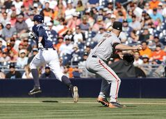 San Francisco Giants starting pitcher Tim Hudson throws to first to make the out on San Diego Padres' Seth Smith on a grounder during the first inning of a baseball game Saturday, July 5, 2014, in San Diego. (AP Photo/Don Boomer)