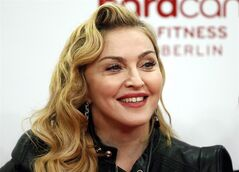 FILE - In this Thursday, Oct. 17, 2013 file photo, U.S. pop star Madonna smiles during her visit at the