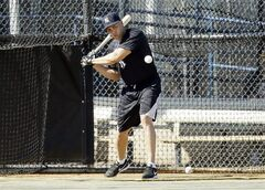 New York Yankees outfielder Carlos Beltran hits in the batting cage during spring training baseball practice, Monday, Feb. 17, 2014, in Tampa, Fla. (AP Photo/Charlie Neibergall)