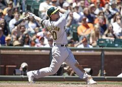 Oakland Athletics' Josh Donaldson hits a two run homer off San Francisco Giants starting pitcher Tim Hudson in the sixth inning of their interleague baseball game Thursday, July 10, 2014, in San Francisco. (AP Photo/Eric Risberg)