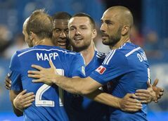 Montreal Impact's Jack McInerney, second right, celebrates with teammates, from left, Justin Mapp, Patrice Bernier and Marco Di Vaio after scoring against the Houston Dynamo during second half MLS soccer action in Montreal, Sunday, June 29, 2014. THE CANADIAN PRESS/Graham Hughes