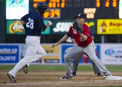 The Winnipeg Goldeyes' Kyle Day (28) is out at first base as Wichita Wingnuts first baseman Greg Porter makes the catch at Shaw Park on Friday night.