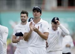 England captain Alastair Cook, center, applauds as he walks off the field of play with man-of-the-match James Anderson, background left, and Ian Bell, background right, after defeating India on the fifth and final day of the third cricket test match of the series between England and India at The Ageas Bowl in Southampton, England, Thursday, July 31, 2014. England's Moeen Ali took six wickets to lead the hosts to a 266-run win over India in the third test on Thursday, squaring the series and ending almost a year without a test victory. (AP Photo/Matt Dunham)