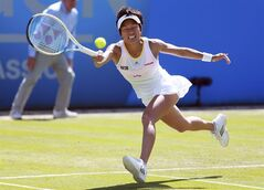 Japan's Kimiko Date-Krumm makes a return to Slovakia's Daniela Hantuchova during the Aegon Classic at Edgbaston Priory Club, Birmingham England Thursday June 12, 2014. (AP Photo/David Davies/PA) UNITED KINGDOM OUT NO SALES NO ARCHIVE