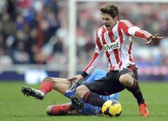 Hull's Robert Koran and Sunderland's Marcus Alonso, compete for the ball during the English Premier League soccer match between Sunderland and Hull City at the Stadium of Light, Sunderland, England, Saturday, Feb. 8, 2014. (AP Photo/Owen Humphreys, PA Wire) UNITED KINGDOM OUT - NO SALES - NO ARCHIVES