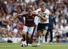 West Ham United's Mark Noble, left, competes for the ball with Tottenham Hotspur's Eric Dier during their English Premier League soccer match at Upton Park, London, Saturday, Aug. 16, 2014. (AP Photo/Sang Tan)