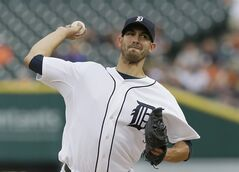 Detroit Tigers starting pitcher Rick Porcello throws during the first inning of a baseball game against the Tampa Bay Rays in Detroit, Sunday, July 6, 2014. (AP Photo/Carlos Osorio)