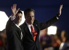 Republican vice -residential nominee, Rep. Paul Ryan, left, and Republican presidential nominee Mitt Romney waves to delegates after his speech at the Republican National Convention in Tampa, Fla., Thursday.