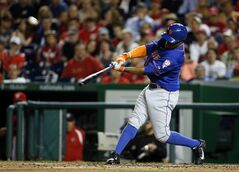 New York Mets' Eric Young Jr. hits an RBI double during the fifth inning of a baseball game against the Washington Nationals at Nationals Park Friday, May 16, 2014, in Washington. (AP Photo/Alex Brandon)