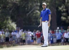 Brendon Todd watches his putt on the second green during the third round of the U.S. Open golf tournament in Pinehurst, N.C., Saturday, June 14, 2014. (AP Photo/David Goldman)